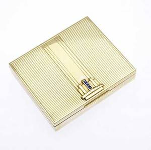 Tiffany  co gold and sapphire cigarette case 14k strapped pinstriped cover with a channel of calibre cut sapphires in an odeonesque ornament ca 1938 1339 gs 3 12 x 3 x 58