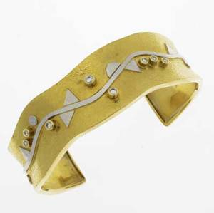 Ross coppelman gold platinum  diamond cuff east dennis mass 18k 22k and platinum in textured undulating shape with fused geometric design and colletset diamonds 26 ct tw ca 1985 479 gs