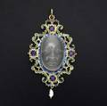 W bauscher enameled gold and moonstone pendant 14k yg carved moonstone mask and four blue sapphires in the renaissance style ca 1985 signed 173 gs 3 x 1 12