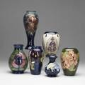 Six vases by moorcroft english 20th c all with various floral decoration three artist signed wm tallest 10 34