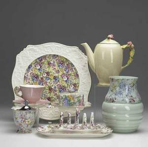 Seven pieces of royal winton chintz english 20th c rosebud teapot petunia cup and saucer marion relish jar dunbardy toast rack victorian rose serving dish sweet pea cake plate tog