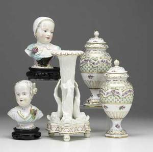 Five pieces of european porcelain 19th20th c pair of french covered urns copeland dolphin decorated vase and a pair of handpainted busts of women tallest 9 14