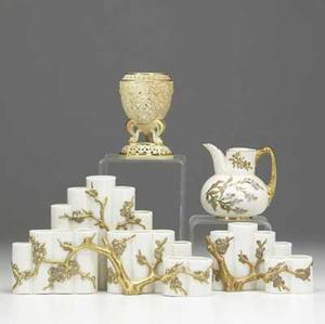 Four pieces of royal worcester late 19thearly 20th c two tubular vases reticulated vase and small pitcher tallest 5 14