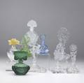 Nine figural glass perfume bottles 20th c daum france clear bulbous base with an amber flower czechoslovakia cut and etched glass with a pair of flamenco dancers and one frosted glass with cherubs