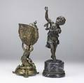 Two bronzes 19th20th c nautilus shell held by a mermaid and a child with arms extended in the air taller 15 34