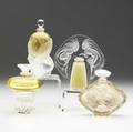 Four lalique perfumes late 20th c le baiser together with three others all unopened tallest 5 34