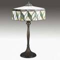 Handel bronze fivesocket lamp base signed handel early 20th c together with a geometric leaded glass shade not matching base 31