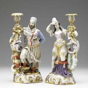 Pair of continental porcelain figural candleholders 19th c bearded man and woman in middle eastern clothing both candleholders with repair to base height 13