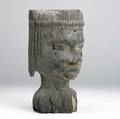 Benin or bini portrait head benin africa carved wooden memorial head of important female ancestor with stylized plaited hair and fine details well weathered face with restoration to several area