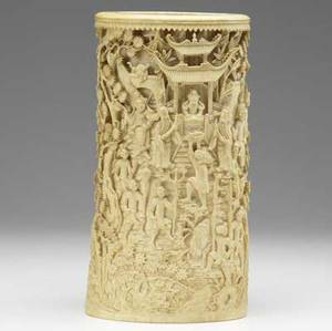 Carved ivory tusk section 19th c profusely carved with asian figures in warrior scenes hollow body height 11