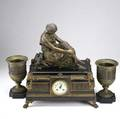 French three piece marble and bronze figural clock set 19th c seated female figure with harp at her side together with a pair of urns time and bell strike movement 21
