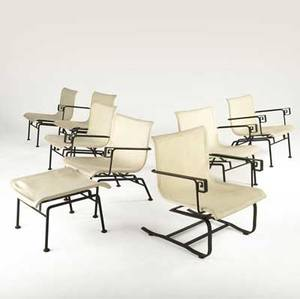 Modern set of seven lounge chairs with canvas seats on iron frames with greek key details three doublearm two singlearm and two armless with single ottoman provenance juan montoya collection