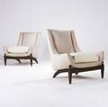 Decorative pair of low armchairs with beige and ivory ultrasuede upholstery on walnut bases provenance hotel phoenix buenos aires argentina 36 x 34 x 29
