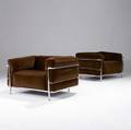 Le corbusier  cassina pair of grand confort club chairs in brown velour upholstery on chromed steel frames marked cassina with embossed signature 24 12 x 38 12 x 28 34