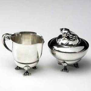 Georg jensen sterling silver cream pitcher and covered sugar bowl in the blossom pattern both stamped georg jensen denmark sterling cream pitcher 3 x 3 34 x 2 12 sugar bowl 3 34 x 3 38