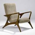 Vladimir kagan contour chair in sculpted walnut with moss green chenille upholstery 39 x 25 12 x 35 12