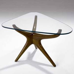 Vladimir kagan trisymmetric side table in sculpted walnut with triangular plate glass top 18 34 x 24 x 29 12