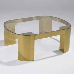 Karl springer coffee table with inset plate glass top on curved brass frame 16 x 42 x 32