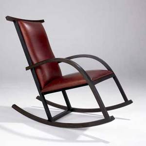 Carlos riart  knoll rosewood rocker upholstered in burgundy leather 38 14 x 24 12 x 41 12
