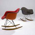 Charles eames  herman miller two fiberglassshell rockers with fabricupholstered seats and birch rockers both have herman miller paper label and embossed mark 28 x 25 12 x 27 12