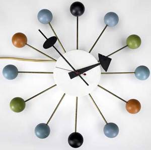 George nelson  howard miller ball clock with enameled metal hands and multicolored wooden spheres radiating from brass spokes howard miller decal 13 14 dia