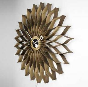George nelson  howard miller large sunflower clock in bentwood with brass accents and enameled metal hands howard miller label 29 34 dia