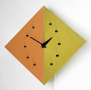 George nelson  howard miller kite clock in rare color combination with black enameled wood numeral markers and metal hands embossed howard miller mark also with foil and clear plastic labels 16 3
