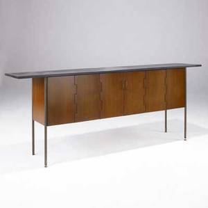 Kip stewart  directional walnut sideboard with polished slate top and two trifold doors concealing interior drawers and shelves on brass legs and adjustable feet directionalcalvin furniture co t
