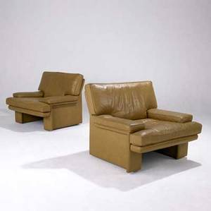 Walter knoll  steelcase pair of sirino lounge chairs with stitched tan leather upholstery marked brayton on upholstery also with brayton international paper tags 31 12 x 38 x 32