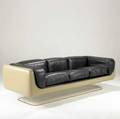 Steelcase threeseat sofa upholstered in black leather with fiberglass shell on lucite base steelcase label25 x 81 12 x 33 12