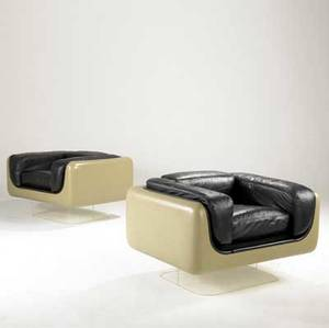 Steelcase pair of club chairs upholstered in black leather with fiberglass shell on lucite base steelcase label 24 12 x 40 12 x 32 12