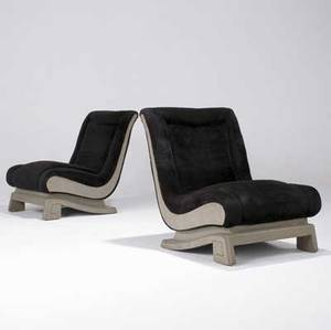 James mont pair of armless sleighshaped lounge chairs with dark brown synthetic upholstery on cerused oak frames one chair has james mont paper label 32 34 x 26 12 x 29 12