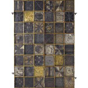 Paul evans pair of welded steel panels with raised and patinated squares arranged in a grid with gilded borders 1965 one marked paul evans 65 d 60 x 20 12 x 2 14