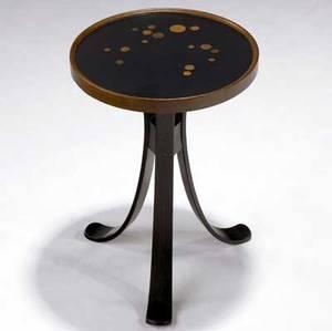Edward wormley  dunbar constellation table with circular wood inlays to black lacquered top on laminated walnut base dunbar brass d tag 18 34 x 13 dia