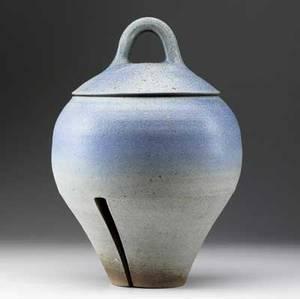 Karen karnes stoneware covered vessel with split base in speckled blue gray and terracotta glaze signed karen karnes in script 17 x 10 34 dia