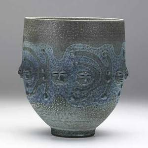 Scheier stoneware vessel with applied decoration of faces covered in frothy blue and purple glazes 1983 signed and dated 9 12 x 8 dia