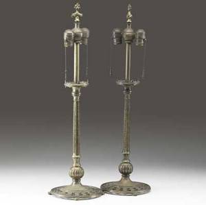 Oscar bach pair of bronze table lamp bases each with two sockets and pierced base both marked with oscar bach metal tags 28 x 8 14