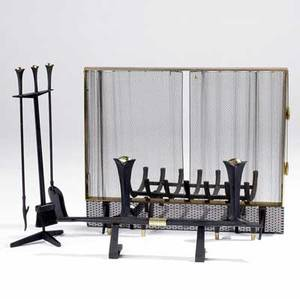 Donald deskey  bennett ninepiece brass and castiron fireplace set consisting of log holder fireplace tools pair of andirons with firedog firescreen and log holder andirons stamped bennett fir