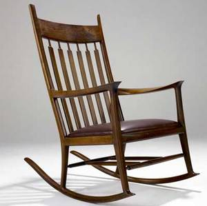 John nyquist sculpted black american walnut rocker with doweled and pinned joinery and burgundy leather upholstery carved jn 45 x 26 x 40