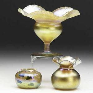 Tiffany studios  steuben three items gold favrile floriform coupe inscribed lctiffanyfavrile 6119g favrile squat bowl in heart and vine inscribed lct 8428a steuben gold aurene vase with fl