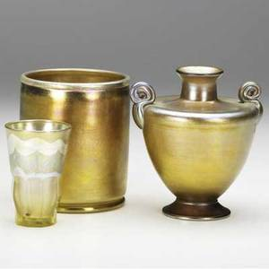 Tiffany studios three gold favrile vessels urn with curled handles etched 1063 9216 m lc tiffanyinc favrile 543688 4 34 gobelet with pulledfeather decoration and cut faceted base etched l