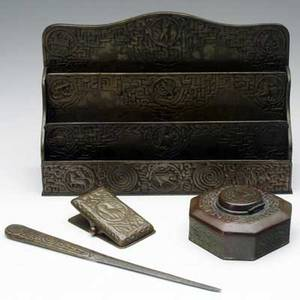 Tiffany studios four desk set pieces in the zodiac pattern paper clip letter opener inkwell and large letter holder all stamped tiffany studios new york with numbers letter holder 8 x 12