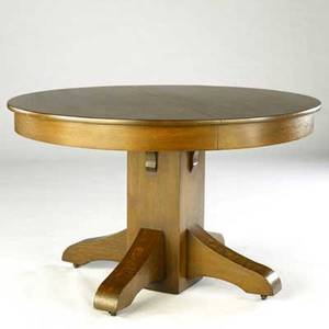 Arts  crafts pedestal dining table with circular top and four feet unmarked 30 x 48 dia