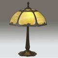 Bradley  hubbard table lamp its pierced shade with a poppy motif lined in green and caramel slag glass over a threesocket arts  crafts base triangular stamp within socket cluster 22 12 x 15 1