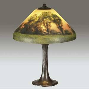 Handel table lamp its etched glass shade obverse and reversepainted with a landscape against a vermillion sky over a threesocket lobed base base stamped shade stamped and signed 22 12 x 18