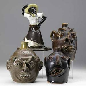Brock  browns pottery four folk art items john brock face jug 1989 8 and figurine momma told me about mrs sadie she liked to dance 11 and two browns pottery face jugs covered in brown r