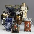 Royal doulton lot of seven items two dewars whiskey jugs sporting squire and the watchman large footed bowl decorated with fruit on cobalt ground pompeian mosaic pitcher egyptian pattern pitche