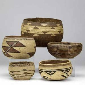 West coast native american five baskets one pacific northwest 7 12 and four hupa early 20th c 6 x 5 20th c later example 6 12 x 5 12 20th c 5 and a 20th c 9 x 6