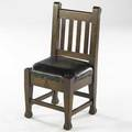 Roycroft childrens mahogany chair the seat upholstered in black vinyl carved orb and cross mark 29 x 14 x 11