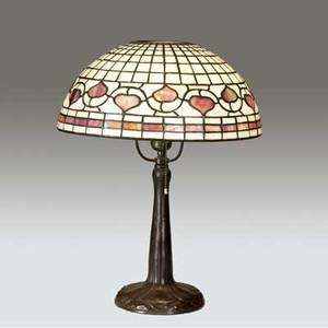 Ah freeman  handel table lamp with a contemporary leaded glass shade in the style of tiffanys lemon leaf with pink heart shaped leaves on an opalescent ground over a handel floriform candlestick